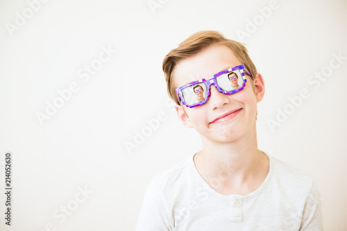 Young boy with glasses in minecraft style with multiple repetition