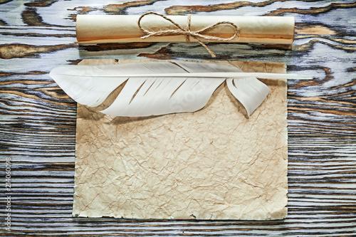 Foto Murales Vintage paper rolls crumpled document plume on wooden board