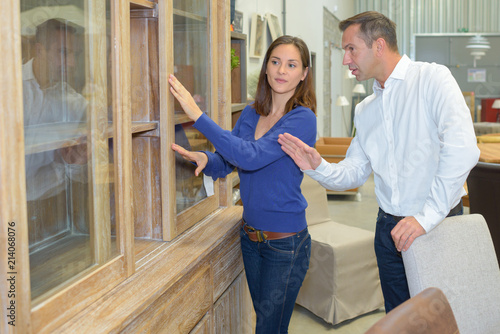 Couple looking at furniture in a shop - 214068076