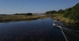 Drone Footage of a boat traveling through the okavango delta. - 214073233