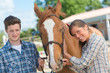 horse enthusiasts posing - 214075613