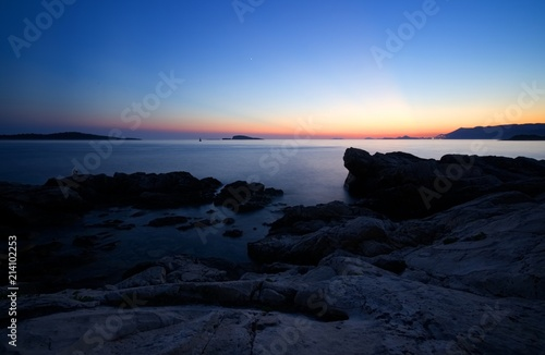 Rocks and sea after sunset - 214102253
