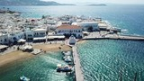 Aerial drone bird's eye view video of iconic old port in chora of Mykonos island, Cyclades, Greece - 214114805