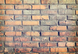 texture of a  brick wall background in the countryside . rough blocks of stone brick masonry horizontal .  architecture wallpaper. - 214127461