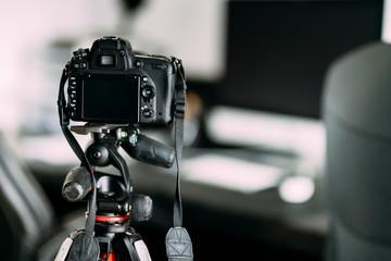 professional photographer taking interior design photos using professional gear, camera and tripod