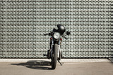 Vintage motorcycle parking near wall of finance building. Everything is ready for having fun driving the empty road on a motorcycle tour journey. Modern man hobby. Space for your individual text. - 214189800