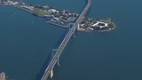 A high angle aerial view of the Throgs Neck Bridge connecting New York City's Queens and Bronx boroughs.  - 214218081