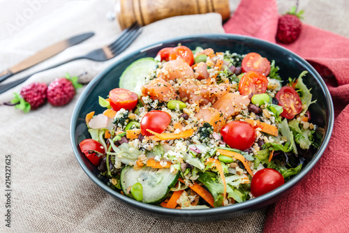 Foto Murales Salmon salad Gourmet cereals Cooked soy beans Cucumber Carrots