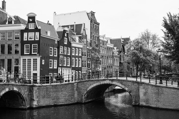Monochrome view from the Keizergracht over the old canals of Amsterdam.