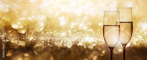 Leinwandbild Motiv Champagne with festive gold background