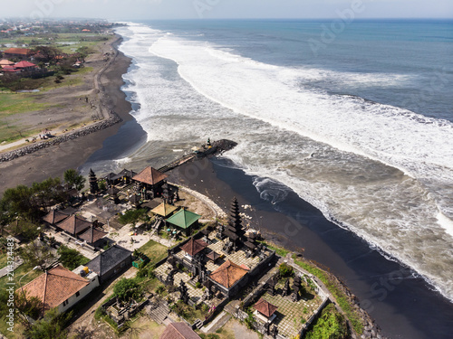 Foto Spatwand Bali Aerial view of a traditional Balinese Hindu temple by a black sand beach in Sanur in Bali in Indonesia