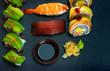 Japanese sushi set on black slate and free copy space