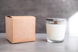 Organic scented soy candle with craft box on grey concrete cement table. Loft interior decor, minimalism concept.  Closeup, copy space for text - 214357039