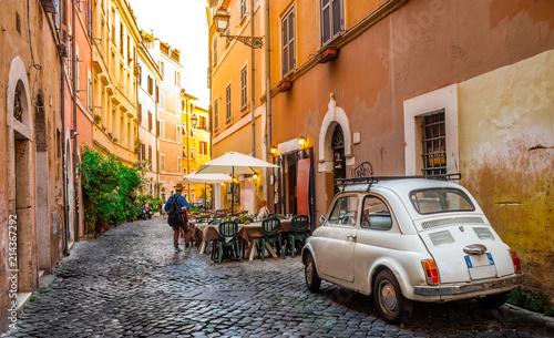 Leinwandbild Motiv Cozy street in Trastevere, Rome, Europe. Trastevere is a romantic district of Rome, along the Tiber in Rome. Turistic attraction of Rome.