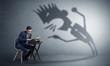 Leinwanddruck Bild - Man working hard and he is afraid of a yelling shadow