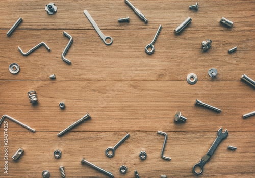 Collection set of house repair tools, wrenchs, screw, bolts on wood table background,flat lay pattern - 214374829