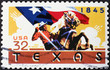 Cowboy with Flag of Texas on american stamp