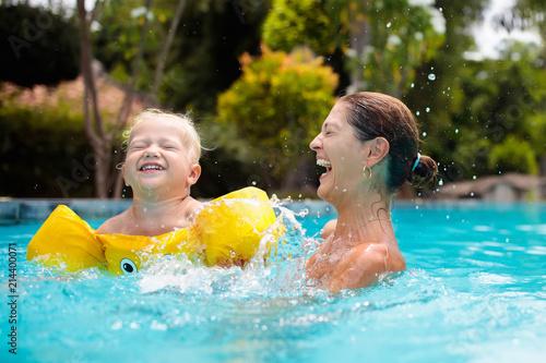 Leinwandbild Motiv Mother and baby in swimming pool