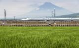 Shizuoka - July 03 : Shinkansen bullet train and Mountain Fuji on July 03 , 2017 , Shizuoka ,Japan. Shinkansen is world's busiest high-speed railway operated by four Japan Railways companies. - 214401805