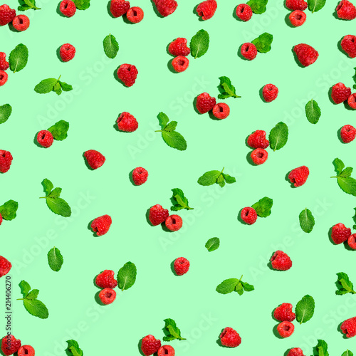 Raspberries and mints on a solid color background - 214406270