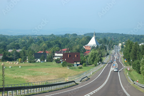 Foto Spatwand Olijf Straight road with green landscape, Poland