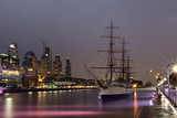 The old ship is on the dock at sunset. Reflectin in thr river.  Buenos Aires, Argentina. South America. Long exposure photography