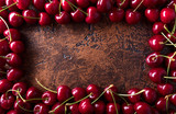 Sweet organic cherries on old copper table.