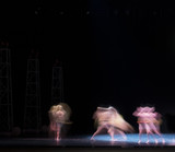 auditorium, view of the stage. ballet dancers silhouettes. Defocused entertainment concert lighting on stage.  - 214442220