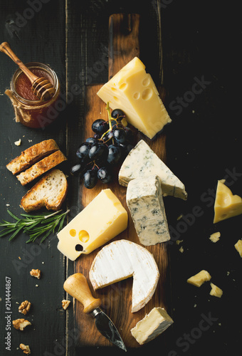 Assorted cheeses with grapes, nuts and rosemary © Belokoni Dmitri