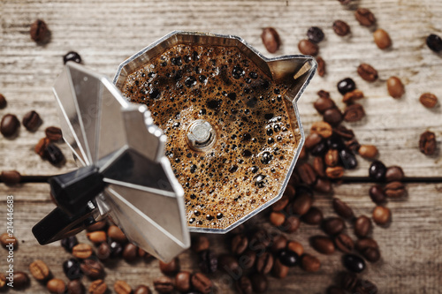 Moka coffee pot and coffee beans on wooden background - 214446683