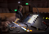music, technology, people and equipment concept - hands using mixing console in sound recording studio - 214448262