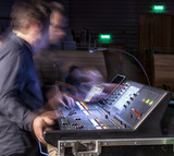 music, technology, people and equipment concept - hands using mixing console in sound recording studio - 214448451