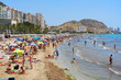 Tourists sunbathing on a Postiguet Beach of Alicante city. Spain - 214452461