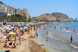 Tourists sunbathing on a Postiguet Beach of Alicante city. Spain