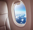 Airplane interior with window view of clouds. - 214487886