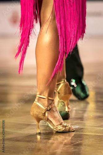 fototapeta na ścianę Beautiful womanish and masculine legs in active ballroom dance, indoors