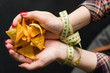 diet eating vs fast food. woman hands tied with measure tape. forbidden chips snack. healthy lifestyle choices
