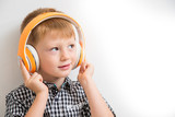 young boy listen music with headphone