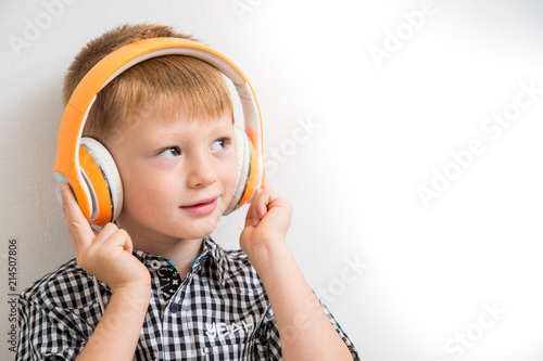 young boy listen music with headphone - 214507806