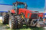 modern tractor for agriculture on the farm with a powerful motor, the flagship of the modern agricultural industry - 214509825