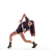 Young beautiful dancer is posing in studio - 214515677