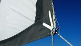 sail of a yacht is wobbling about in the light breeze - 214536485