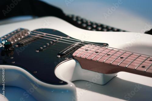 closeup.black guitar on a white background. - 214541007