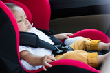 Baby boy sitting in a car seat . safety chair - 214546039
