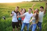 group of joyful youth on the field - 214548099