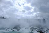 Mist and spray rising up from the rocks at the bottom of Niagara Falls to meet the clouds