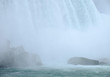 Mist and spray rising from the bottom of Niagara Falls as the water hits rocks