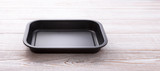 Empty baking tray for pizza close up on wooden background top view horizontally. Mock up for design - 214559222