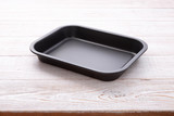 Empty baking tray for pizza close up on wooden background top view horizontally. Mock up for design - 214559233