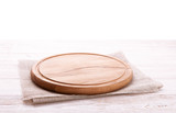 Napkin and board for pizza on wooden desk. Canvas, dish towels on white wooden table background top view mock up. Selective focus. - 214559618